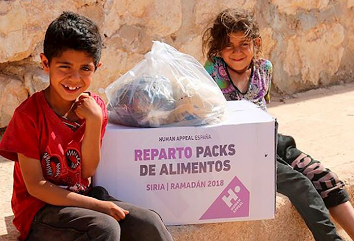 two young children with a human appeal box